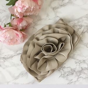 Shoedazzle faux leather rosette clutch